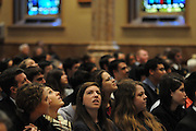 "Catholic high schools students peer at the ornate ceiling of Holy Name Cathedral as Chicago Archbishop Francis Cardinal George details the building's history during a mass promoting service leadership in the church under the theme ""A Call To Serve""."