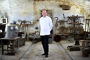 Ulrich Kerz, Chef to the Federal Chancellor of Germany Angela Merkel, poses for a portrait in the Cascina Colombara during the annual meeting of the Club des Chefs des Chefs in Livorno Ferraris, Vercelli, Italy, July 18, 2015.<br /> The Club des Chefs des Chefs, which is seen as the world's most exclusive gastronomic society, has extremely strict membership criteria: to be accepted into this highly elite club, you need to be the current personal chef of a head of state. If he or she does not have a personal chef, members can be the executive chef of the venue that hosts official State receptions. One of the society's primary purposes is to promote major culinary traditions and to protect the origins of each national cuisine. The Club des Chefs des Chefs also aims to develop friendship and cooperation between its members, who have similar responsibilities in their respective countries. <br /> The annual meeting of the Club has been hosted this year in the production site of the Italian rice company called Riso Acquerello. <br /> © Giorgio Perottino