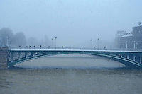 Paris, bridge during a snow storm - Photograph by Owen Franken