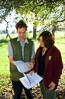 farmer discussing plans for his orchard with a planning officer