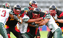 08.07.2011, Tivoli Stadion, Innsbruck, AUT, American Football WM 2011, Group A, Germany (GER) vs Mexico (MEX), im Bild Jerome Morris (Germany, #31, RB) get stopped by the mexican defense // during the American Football World Championship 2011 Group A game, Germany vs Mexico, at Tivoli Stadion, Innsbruck, 2011-07-08, EXPA Pictures © 2011, PhotoCredit: EXPA/ T. Haumer