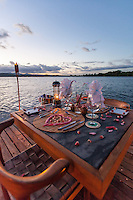 A table is set for a private romantic dinner on the floating dock at Jicaro Island Ecolodge, Granada, Nicaragua