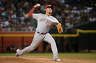 PHOENIX, AZ - JULY 08:  Luis Castillo #58 of the Cincinnati Reds delivers a pitch during the first inning of the MLB game against the Arizona Diamondbacks at Chase Field on July 8, 2017 in Phoenix, Arizona.  (Photo by Jennifer Stewart/Getty Images)