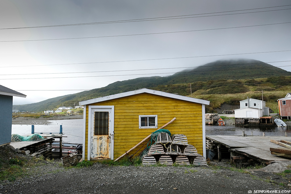 Colorful homes, docks and fishing vessels in the rural fishing town of Trout River, Gros Morne National Park, Canada.
