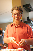 Al Franken at home in Minneapolis  June 2008..Preparing steaks for the BBQ....Photograph by Owen Franken .. Senator Al Franken at home in Minneapolis, Minnesota Al Franken