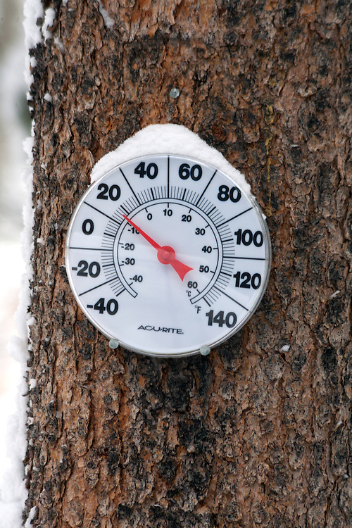 Thermometer with a snow cap shows a common winter temperature in Colorado.