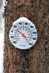 Thermometer with a snow cap shows a common winter temperature in Colorado.