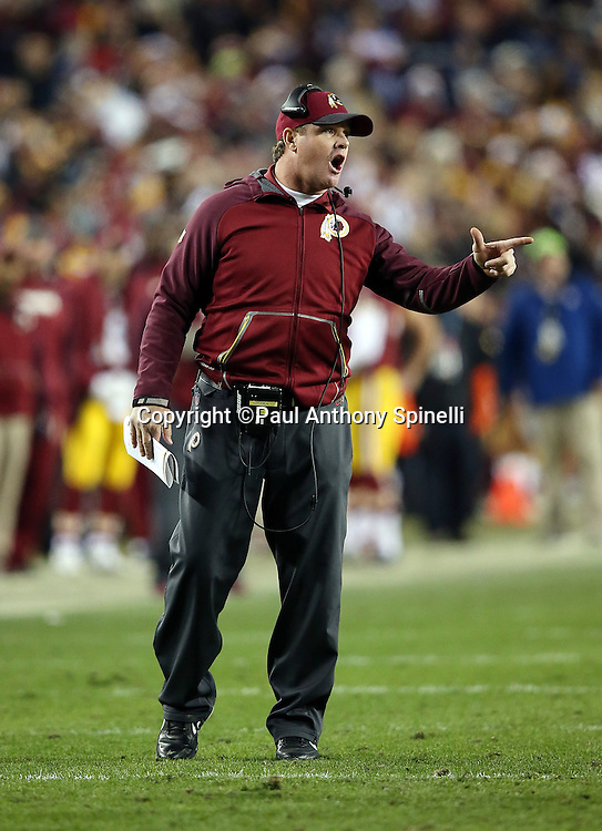 Washington Redskins head coach Jay Gruden yells out at the officials after a penalty call goes against the Redskins during the 2015 week 13 regular season NFL football game against the Dallas Cowboys on Monday, Dec. 7, 2015 in Landover, Md. The Cowboys won the game 19-16. (©Paul Anthony Spinelli)