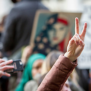 demonstrators gathered near the White House to protest the executive order issued by President Trump yesterday, banning refugees, migrants and foreign nationals from seven majority Muslim nations from entering the United States.  Many of the protestors saw it as targeted effort to restrict Muslim immigrants.  The effect of the executive order was that many airports were thrown into confusion as many US residents with green cards were detained at airports upon attempting to reenter the United States.  John Boal Photography