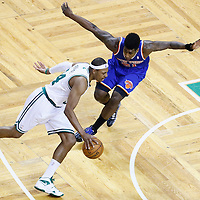26 April 2013: New York Knicks small forward Iman Shumpert (21) defends on Boston Celtics small forward Paul Pierce (34) during Game Three of the Eastern Conference Quarterfinals of the 2013 NBA Playoffs at the TD Garden, Boston, Massachusetts, USA.