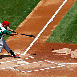 March 17, 2012; Lakeland, FL, USA; St. Louis Cardinals left fielder Matt Holliday (7) hits a two run homerun during the top of the first inning of a spring training game against the Detroit Tigers at Joker Marchant Stadium. Both teams wore green jerseys and the field was marked with shamrocks for the St. Patrick's Day game. Mandatory Credit: Derick E. Hingle-US PRESSWIRE
