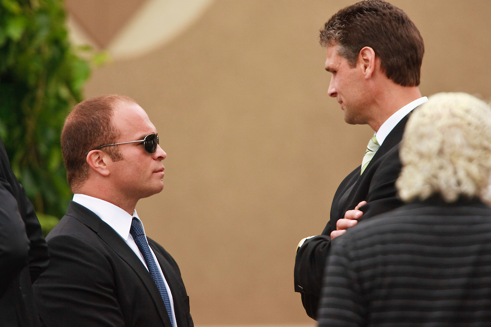 Former enforcers Tie Domi and Stu Grimson talk following the funeral for Detroit Red Wings tough guy Bob Probert in Windsor, Ontario,July 9, 2010, after Probert's sudden death earlier this week at the age of 45.<br /> The Canadian Press/GEOFF ROBINS