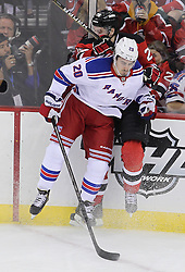 May 19, 2012; Newark, NJ, USA; New York Rangers left wing Chris Kreider (20) hits New Jersey Devils defenseman Mark Fayne (29) during the first period in game three of the 2012 Eastern Conference Finals at the Prudential Center.