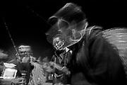 Vietnam, Sapa :  Black H'mong minorities old woman selling jewellery in the night.