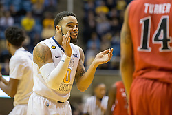 West Virginia Mountaineers guard Jaysean Paige (0) celebrates after a foul called against Texas Tech during the first half at the WVU Coliseum.