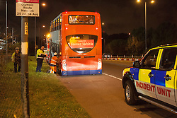 © licensed to London News Pictures. London, UK 01/08/2012. A cyclist was struck by an official Olympic bus and died at the scene which is at the junction of the Eastway and the A12 East Cross Route, close to the northwestern corner of the Olympic Park at around 7.40pm on 01/08/12. The official Olympic bus, which involved to the incident, being lifted to be investigated at the crime scene.  Photo credit: Tolga Akmen/LNP