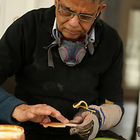 Once he has completed his carving, Gupta adds linseed oil to the wood, lets it sit, and later applies more.