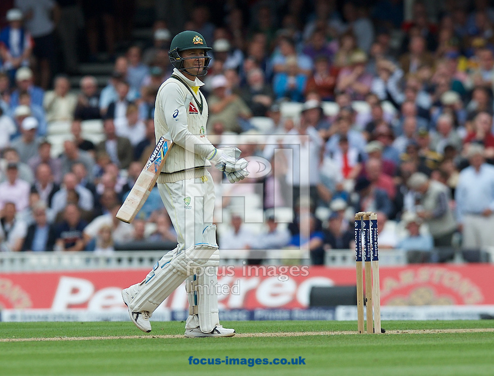 Captain Michael Clarke of Australia leaves the wicket after  being caught by Wicketkeeper Jos Buttler of England off a ball from Ben Stokes  during the 5th Investec Ashes Test Match match at the Kia Oval, London<br /> Picture by Alan Stanford/Focus Images Ltd +44 7915 056117<br /> 20/08/2015
