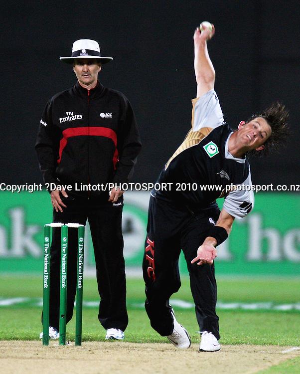 NZ's Shane Bond bowls past umpire Billy Bowden.<br /> 1st Twenty20 cricket match - New Zealand v Australia at Westpac Stadium, Wellington. Friday, 26 February 2010. Photo: Dave Lintott/PHOTOSPORT