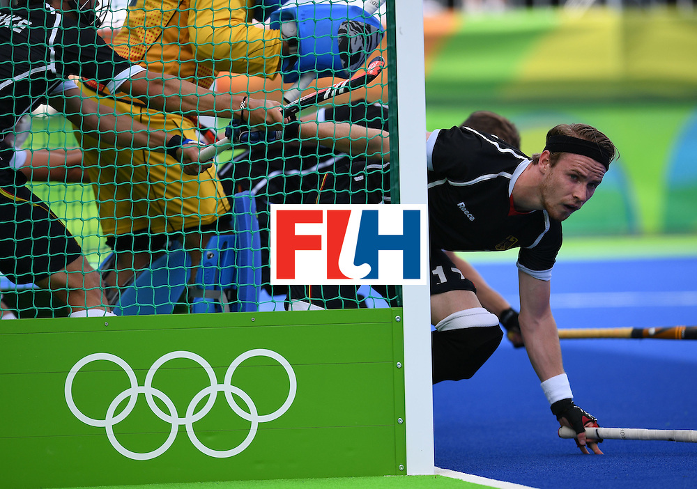 Germany's Christopher Ruhr defends his goal during the men's field hockey Argentina vs Germany match of the Rio 2016 Olympics Games at the Olympic Hockey Centre in Rio de Janeiro on August, 11 2016. / AFP / MANAN VATSYAYANA        (Photo credit should read MANAN VATSYAYANA/AFP/Getty Images)