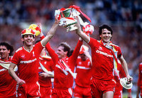Alan Hansen (left) and Jim Beglin parade the FA Cup after Liverpool's victory. Liverpool v Everton, FA Cup Final 1986 at Wembley Stadium. Credit: Colorsport / Andrew Cowie