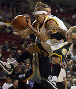 Seattle SuperSonics' Delonte West rebounds the ball during second quarter of NBA basketball action, in Seattle, on Tuesday, Feb. 19, 2008. (AP Photo/Kevin P. Casey)