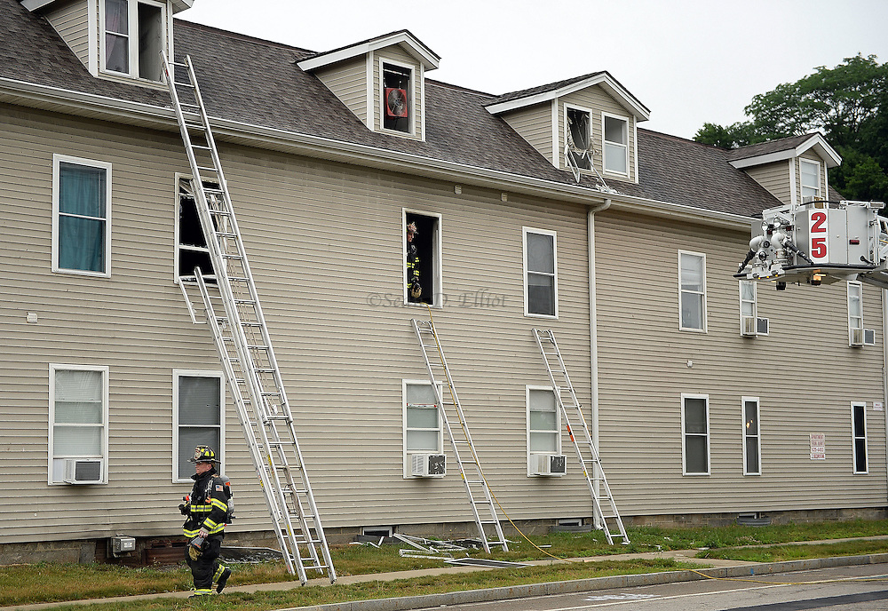 7/5/16 :: NEWS :: BOYLE :: Firefighters clean up after extinguishing a fire at 17 Taftville-Occum Rd. in the Occum section of Norwich Tuesday, July 5, 2016. Nobody was injured in the blaze which began in the kitchen of unit 9 on the second floor of the building. Mutual aid from Baltic, Yantic, Taftville and the Mohegan Tribal Fire Department assisted. . (Sean D. Elliot/The Day)