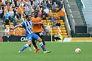 Dale Stephens tackles Sheyi Ojo during the Sky Bet Championship match between Wolverhampton Wanderers and Brighton and Hove Albion at Molineux, Wolverhampton, England on 19 September 2015. Photo by Alan Franklin.