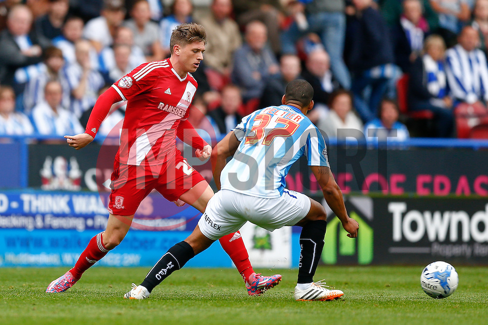 Adam Reach of Middlesbrough is challenged by Lee Peltier of Huddersfield - Photo mandatory by-line: Rogan Thomson/JMP - 07966 386802 - 13/09/2014 - SPORT - FOOTBALL - Huddersfield, England - The John Smith's Stadium - Huddersfield town v Middlesbrough - Sky Bet Championship.