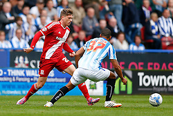 Adam Reach of Middlesbrough is challenged by Lee Peltier of Huddersfield - Photo mandatory by-line: Rogan Thomson/JMP - 07966 386802 - 13/09/2014 - SPORT - FOOTBALL - Huddersfield, England - The John Smith's Stadium - Huddersfield town v Middlesbrough - Sky Bet Championship.