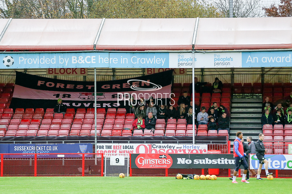 The travelling Forest Green Rovers fans with banner during the EFL Sky Bet League 2 match between Crawley Town and Forest Green Rovers at the Checkatrade.com Stadium, Crawley, England on 11 November 2017. Photo by Phil Duncan.