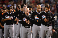 PHOENIX, AZ - JUNE 12:  Don Mattingly #8 of the Miami Marlins stands with his team observe a moment of silence for the victims in the Pulse nightclub terror attack in Orlando prior to the MLB game against the Arizona Diamondbacks at Chase Field on June 12, 2016 in Phoenix, Arizona.  (Photo by Jennifer Stewart/Getty Images)