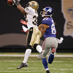 2009 October 18: New Orleans Saints cornerback Jabari Greer (32) breaks up a pass intended for New York Giants wide receiver Domenik Hixon (87) during the first half at the Louisiana Superdome in New Orleans, Louisiana.