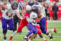 NORMAL, IL - October 06: Chris Zobrist attempts to keep Zachary Mathews from tackling Steve McShane during a college football game between the ISU (Illinois State University) Redbirds and the Western Illinois Leathernecks on October 06 2018 at Hancock Stadium in Normal, IL. (Photo by Alan Look)