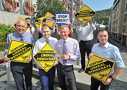 Pictured: Lib Dem councillor on South Lanarkshire council Robert Brown, councillor Mark McGeever, Willie Rennie and Lib Dem Chief Executive Matthew Clark and activists.<br /> <br /> South Lanarkshire Conservative Councillor Mark McGeever has defected to the Scottish Liberal Democrats, following the election of Boris Johnson as the new Conservative leader and Prime Minister. He has represented Hamilton West and Earnock since 2017.<br /> <br /> © Dave Johnston / EEm