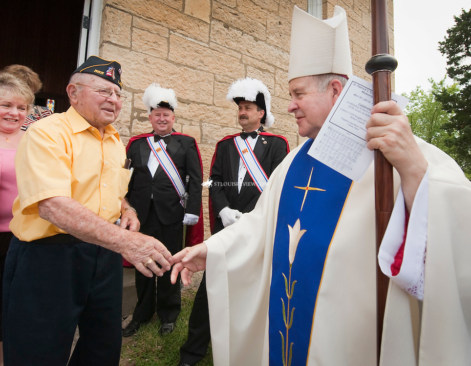 "After celebrating mass for Memorial Day at St. Patrick's ""Old Rock Church"" in Catawissa, Archbishop Carlson greeted WWII veteran Leonard Gildehaus.  The 92- year-old former first sergeant was in the 12th Armored Division, nicknamed the Hellcats, in Europe during the war."