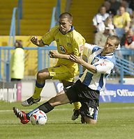 Photo: Aidan Ellis.<br /> Sheffield Wednesday v Leeds United. Coca Cola Championship. 27/08/2006.<br /> Wednesday's Kenny Lunt takes out Leeds David Healy