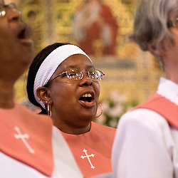 2 AUG. 2015 -- ST. LOUIS -- Members of the choir at Sts. Teresa and Bridget Catholic Parish performs during Mass Mob III held at the church in St. Louis Sunday, Aug. 2, 2015. The event brings Catholics from across the Archdiocese of St. Louis to worship at historic, urban parishes.<br /> <br /> Photo by Sid Hastings.