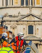 Essential maintenace by masked workers on the Millennium Bridge - Anti Coronavirus (Covid 19) outbreak in London.