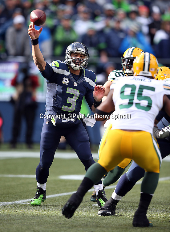 Seattle Seahawks quarterback Russell Wilson (3) throws an incomplete pass that forces a first quarter punt during the NFL week 20 NFC Championship football game against the Green Bay Packers on Sunday, Jan. 18, 2015 in Seattle. The Seahawks won the game 28-22 in overtime. ©Paul Anthony Spinelli