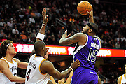 Oct. 30, 2010; Cleveland, OH, USA; Sacramento Kings power forward DeMarcus Cousins (15) shoots over Cleveland Cavaliers power forward Anderson Varejao (17) and power forward Antawn Jamison (4) during the third quarter at Quicken Loans Arena. The Kings beat the Cavaliers 107-104. Mandatory Credit: Jason Miller-US PRESSWIRE