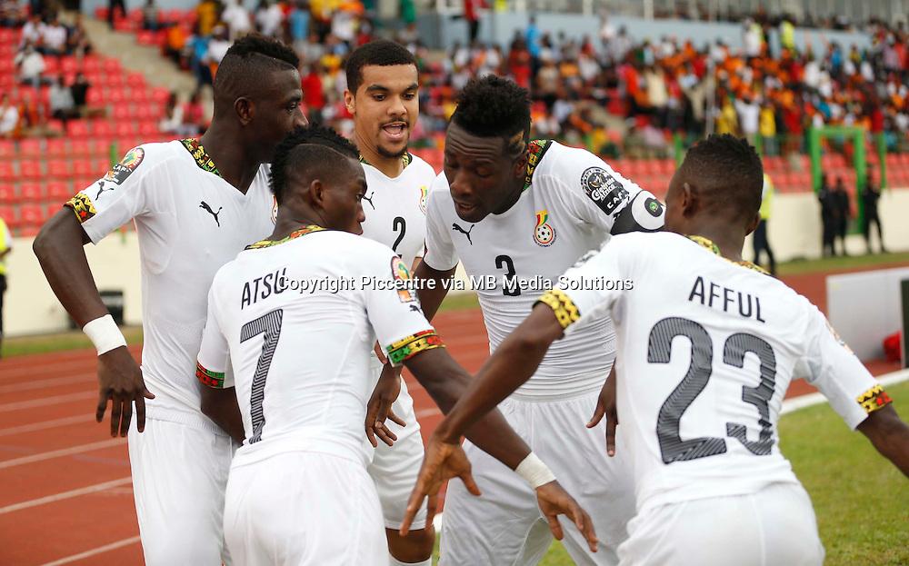 Ghana player Christian Atsu (L) celebrate with teamates scoring a goal against Guinea during their AFCON 2015 Quarter Finals Match on February 1 2015 at Estadio de Malabo Equatorial Guinea. Photo/Mohammed Amin/www.pic-centre.com (Equatorial Guinea)