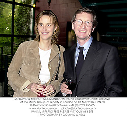MR DAVID & the HON.MRS MONTGOMERY, he was former Chief Executive of the Mirror Group, at a party in London on 1st May 2002.	OZN 50