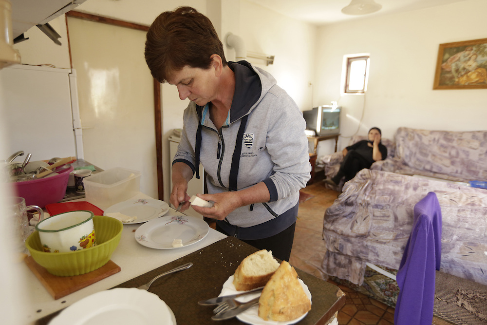 Stanica 'Caka' Mitric, the guesthouse host, preparing homemade food at the village of Nedajno, Durmitor, Montenegro.