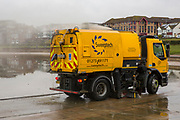 A bright yellow Sweeptech specialised vehicle cleaning out rubbish and silt from the bottom of Hove Lagoon, Kingsway,  Hove, East Sussex, United Kingdom. <br />  (photo by Andrew Aitchison / In pictures via Getty Images)