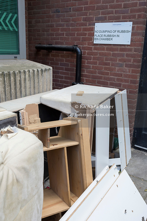 Dumped waste and old furniture beneath a sign of property owners London & Quadrant, asking for the dumping of rubbish only in a designated area, on 14th May 2017, in London, England. L&Q is one of the UK's leading housing associations and one of London's largest residential developers. We own or manage over 90,000 homes in London and the South East.