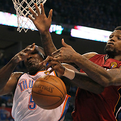Jun 12, 2012; Oklahoma City, OK, USA;  Oklahoma City Thunder center Kendrick Perkins (5) and Miami Heat power forward Udonis Haslem (40) battle for a rebound during the third quarter of game one in the 2012 NBA Finals at the Chesapeake Energy Arena.  Mandatory Credit: Derick E. Hingle-USA TODAY SPORTS