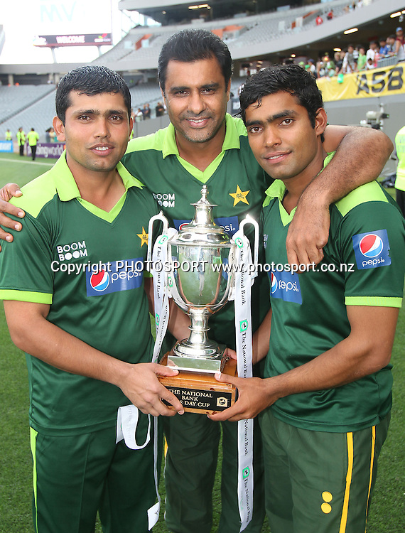 L_R Kamran Akmal, Waqar Younis and Umar Akmal pose for a photo with the National Bank ODI Cup at the conclusion of the 6th ODI, Black Caps v Pakistan, One Day International Cricket. Eden Park, Auckland, New Zealand. Saturday 5 February 2011. Photo: Andrew Cornaga/photosport.co.nz