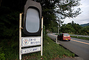 A sign marking the entrance to the town features a giant ink stone and a message that reads ?The home of Japan's Finest Ink Stones? in Ogatsu, Ishinomaki City, Japan on 9 Sept. 2012.  Photographer: Robert Gilhooly