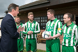 © Licensed to London News Pictures. 03/05/2015. Nuneaton, Warwickshire, UK. The Prime Minister David Cameron visited Ambleside sports club in Nuneaton, Warwickshire, earlier today. Pictured, David Cameron chats to Ambleside FC captain Matt Hall who is raising money in memory of his daughter Georgie who died of Meningitis at 23 months. Photo credit : Dave Warren/LNP